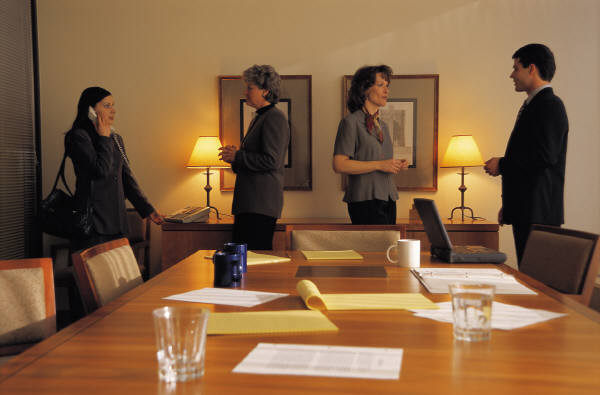 Boardroom meeting with members greeting one-another