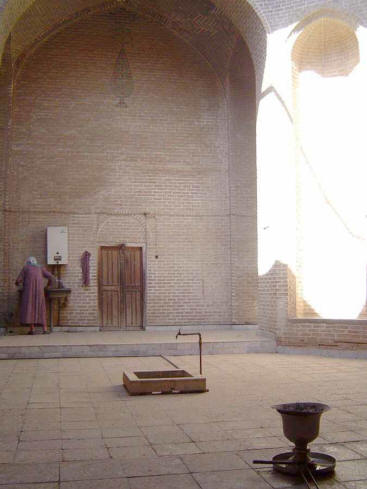Fire temple in Mahale-ye Yazd. Note woman caretaker at far wall